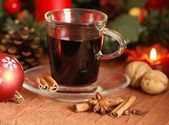 Hot wine with spices and christmas decorations