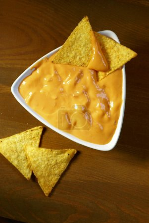 Photo for Top view of tortilla corn chips and cheese dip. - Royalty Free Image