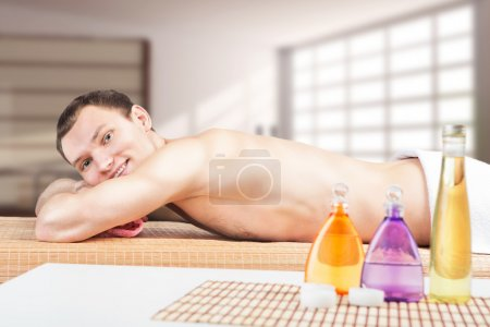 Photo for Handsome sporty man in spa salon. Young man is going to have massage in a spa center - Royalty Free Image