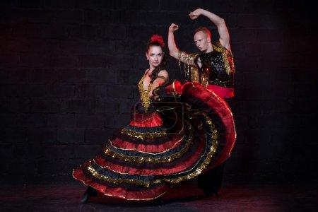 Photo for Young couple dancing flamenco, studio shot. - Royalty Free Image