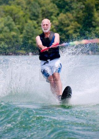 Active senior man on slalom ski