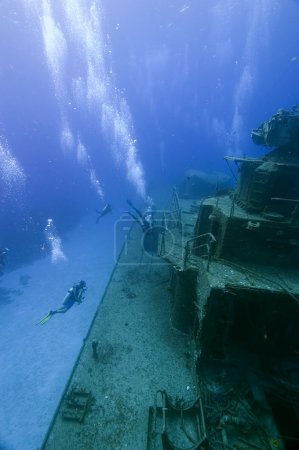Divers exploring shipwreck