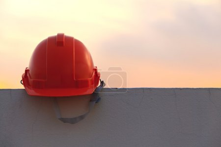 Construction helmet at sunset