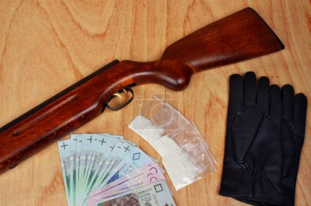 Bags of drugs,  polish money and gun