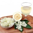 Health drink made from elderberry flowers on a whi...