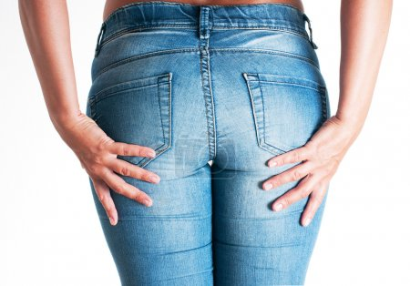 Perfect woman body in blue jeans isolated on white background.
