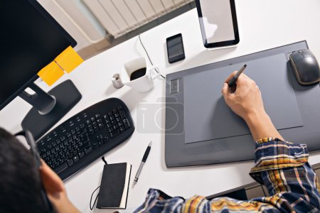 Photo for Young graphic designer working in office - Royalty Free Image