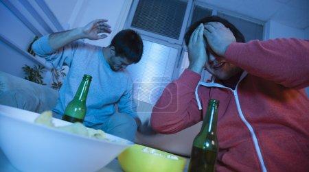 Friends Watching Sport Match On TV