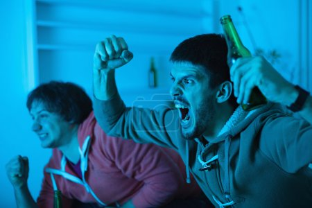 Men watching sports competition