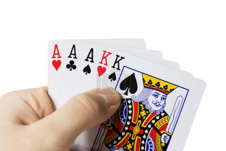 Man holding cards in hand, playing poker