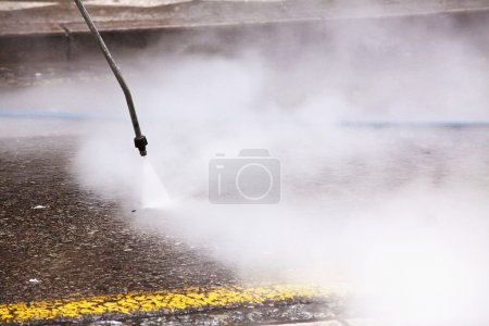 Cleaning the streets with water pressure