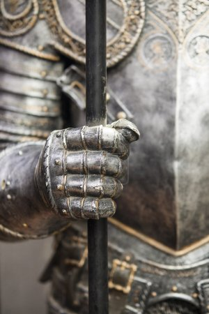 Detail of a medieval knight armor with sword...