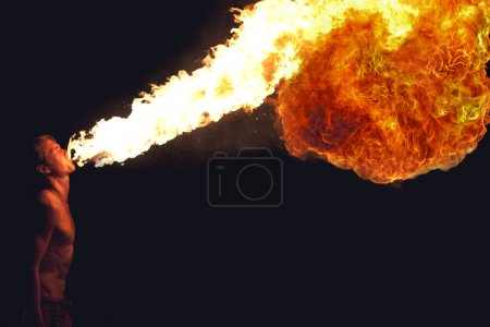 Photo for Fire show artist breathe fire in the dark - Royalty Free Image