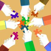 Person making a puzzle A hand puts proper puzzle Businessman assembling jigsaw puzzle Business concept