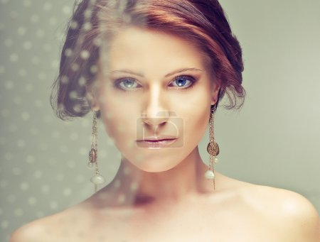 Beautiful woman with earrings