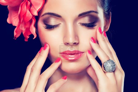 beautiful woman with trendy make-up and manicure