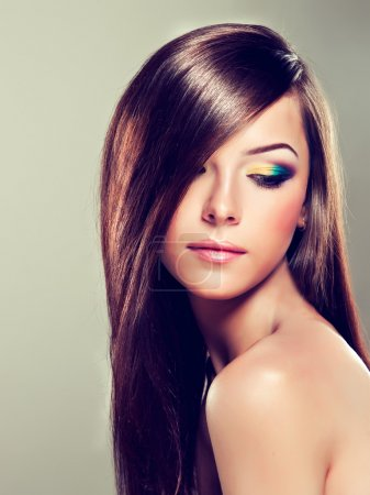 Brunette with long hair and modern make-up