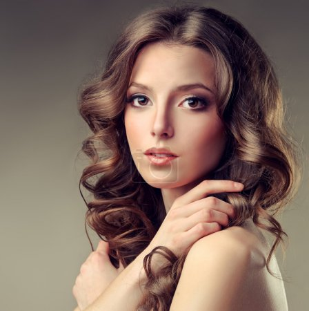 Photo for Beautiful brunette woman with long curly hair - Royalty Free Image