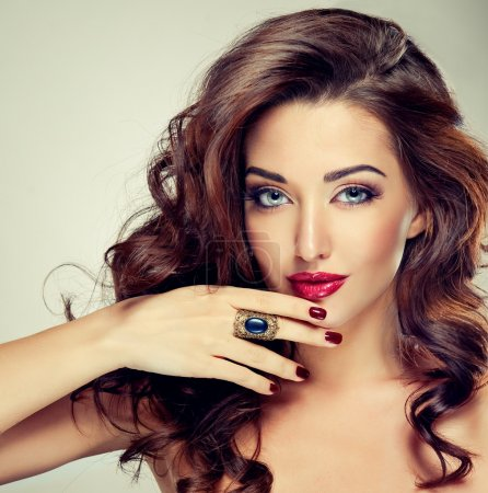 Sensual brunette woman with curly hair