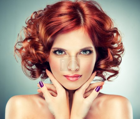 Redhead woman with bright makeup and manicure