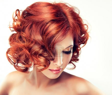 Redhead woman with bright makeup looking down