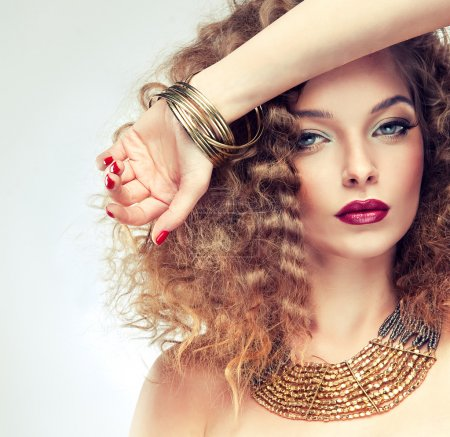 Photo for Beautiful curly woman  with stylish bijouterie and makeup - Royalty Free Image