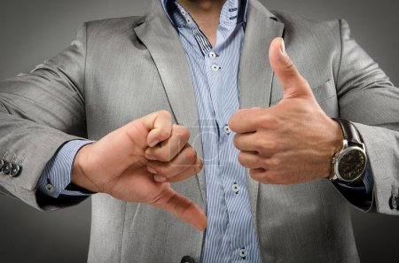 Image of a business man with both thumbs pointing ...