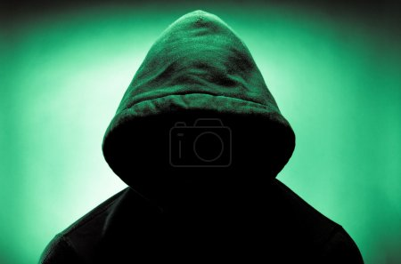Photo for Man wearing hood with face in shadows - Royalty Free Image