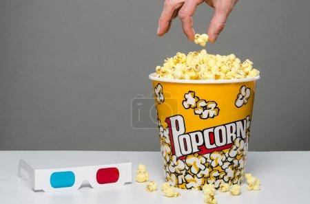 Hand grabbing some popcorn