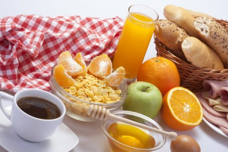 Photo for Breakfast with coffee, bread, honey, juice, egg - Royalty Free Image