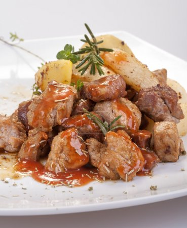 Photo for Fresh roast pork in sauce with rosemary and potatoes - Royalty Free Image