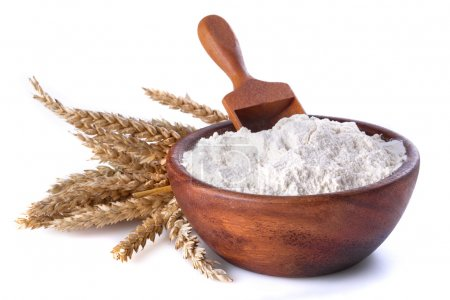 Flour with wheat in a wooden bowl and shovel on a ...