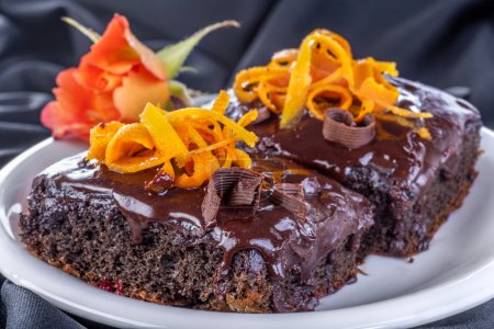 Photo for Delicious and sweet chocolate cake decorated with rose and orange - Royalty Free Image