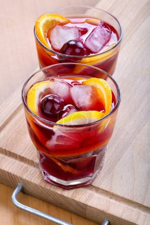 Photo for Ice refreshing summer drink with lots of different fruits - Royalty Free Image