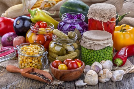 Photo for Several kinds of healthy domestic canned vegetables in jars - Royalty Free Image