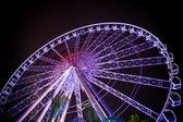 Ferris wheel in motion at amusement park