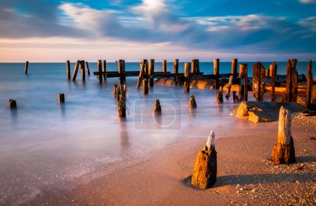 Long exposure at sunset of pier pilings in the Delaware Bay at S