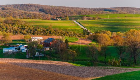 Houses, roads, farm fields and rolling hills of Southern York Co