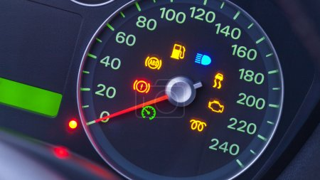Photo for A closeup on the dashboard of a modern car with many warning lights. - Royalty Free Image