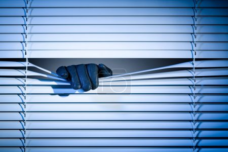 Thief Peeking Through a Window at Night