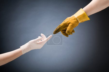 Doctor and Worker Hands Touching