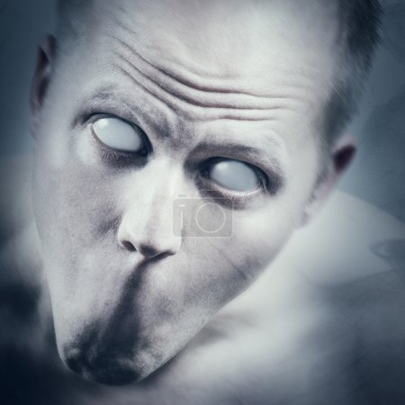 Psychedelic and scary man with white eyes and no m...