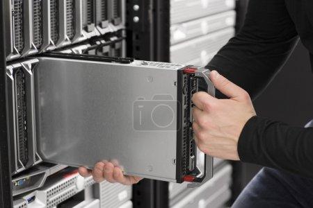 IT Engineer insert a Blade Server in Data Center