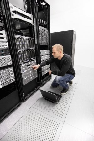 It engineer working in datacenter