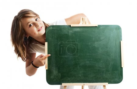 little girl pointing a sign at the school blackboard