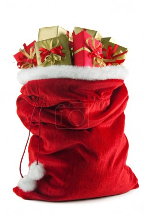 Photo for Santa Claus bag full of christmas presents over white background - Royalty Free Image