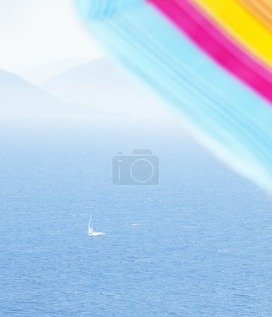 Parasol and sailingship in summertime