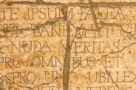 Photo for Cracked plaque with Latin inscriptions and Roman letters, marble background. - Royalty Free Image