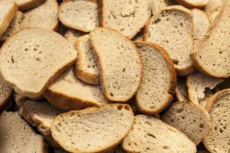 Many slices of stale bread. Old bread thrown in th...
