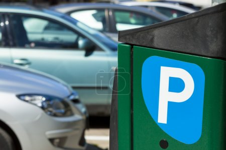 Paid parking for cars in city.